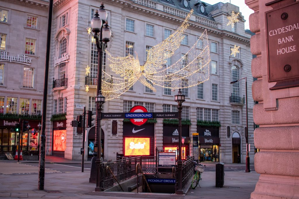 Scene of Christmas lights and a deserted entrance to Piccadilly Circus Underground Station.